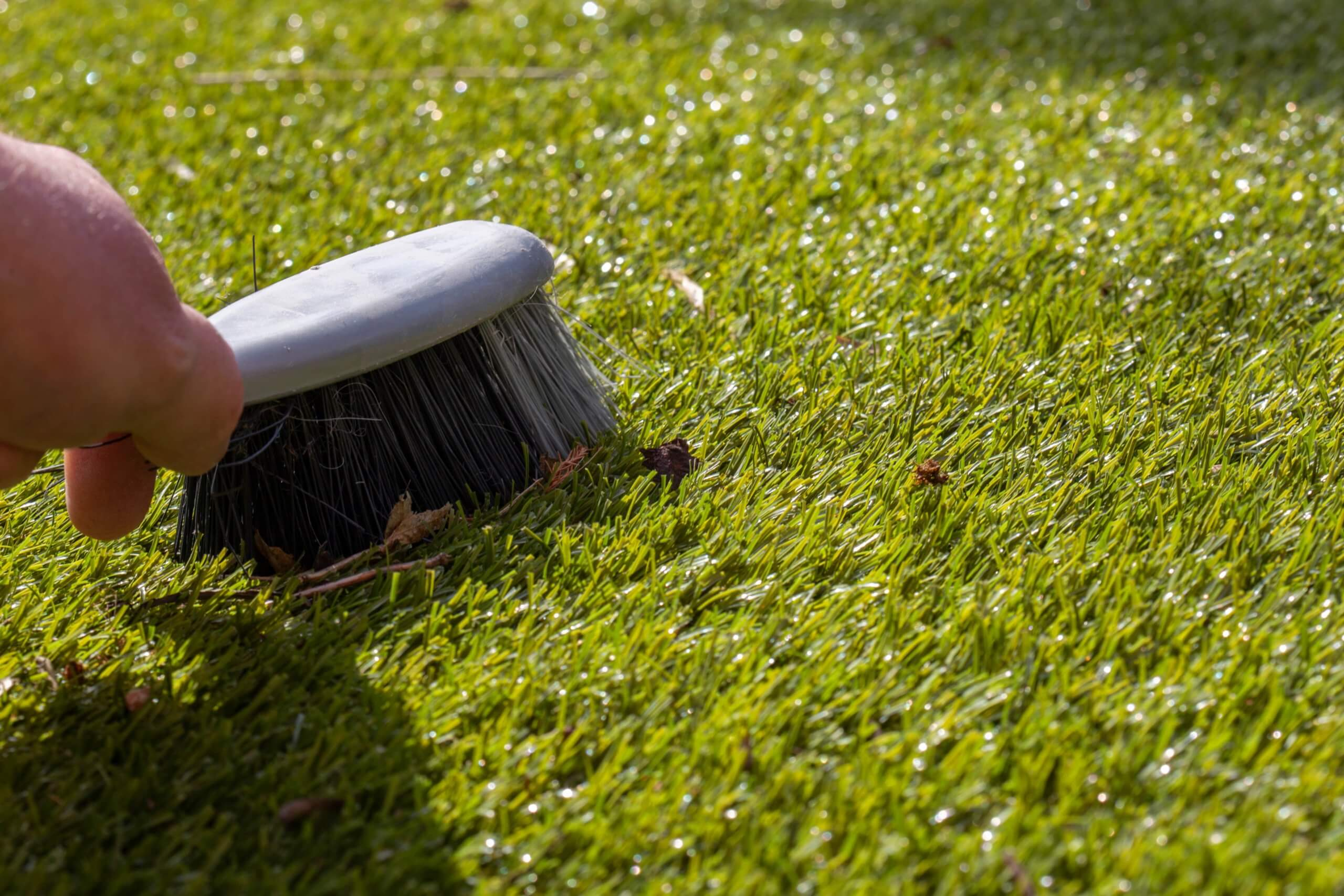 brushing artificial grass